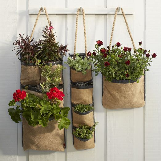 Our Hanging Bag Planters are ideal for an apartment terrace, fence, pergola or porch. Made from durable tarpaulin and burlap, they allow air circulation and gradual water drainage. Grommets make it simple to attach to the wall so you can grow herbs, flowers or even vegetables in small spaces.