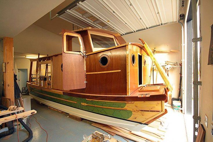 Kerry Elwood's homemade mini-houseboat will fit out the door of his mom's garage in South Salem ...