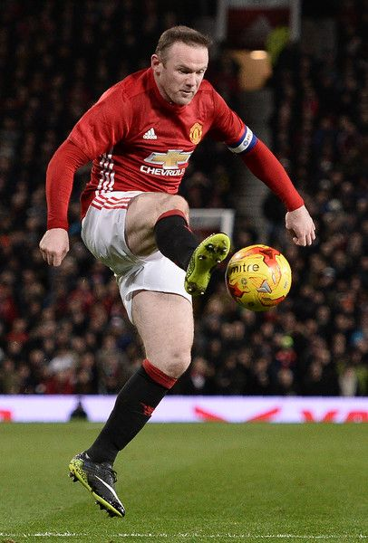 Manchester United's English striker Wayne Rooney jumps to control the ball during the EFL (English Football League) Cup semi-final football match between Manchester United and Hull City at Old Trafford in Manchester, north west England on January 10, 2017. / AFP / Oli SCARFF / RESTRICTED TO EDITORIAL USE. No use with unauthorized audio, video, data, fixture lists, club/league logos or 'live' services. Online in-match use limited to 75 images, no video emulation. No use in betting, games or…