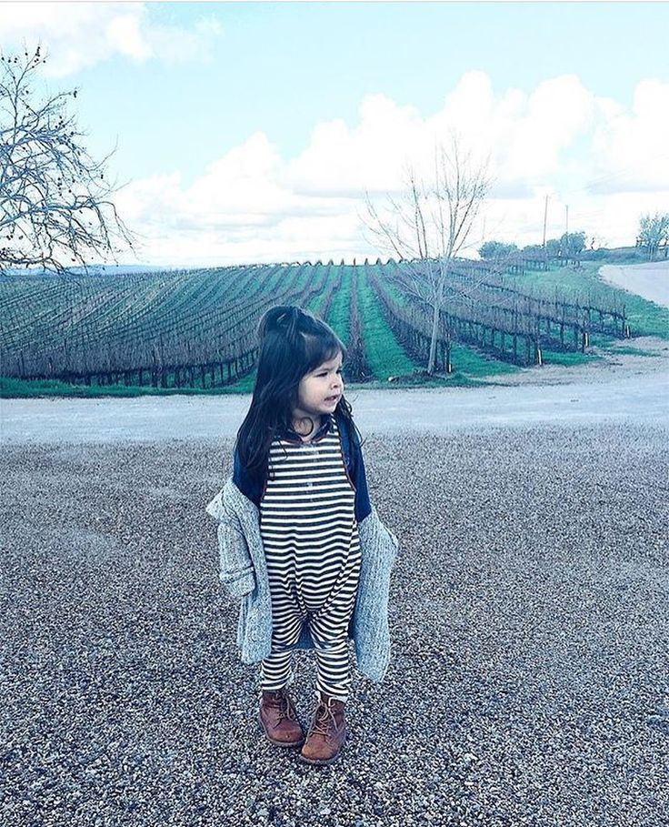 What a view. thank you @love4mateo_olivia I love seeing little Livy in our striped wharf jumpsuit! #carlymegan | children's clothing kids style baby style fashionable kids modern baby clothing