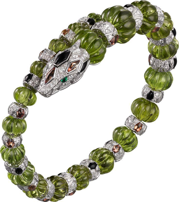 CARTIER Snake Bracelet - white gold, melon-cut peridots, orange sapphires, onyx, emerald eyes, brilliant-cut diamonds. #CartierMagicien
