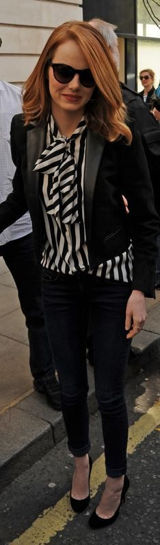 Who made Emma Stone's white stripe top, black blazer, suede pumps, and blue skinny jeans that she wore in London? - OutfitID