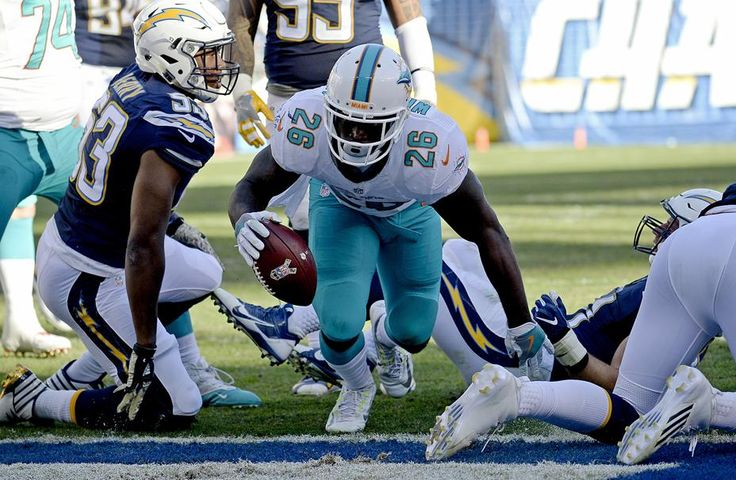 Dolphins vs. Chargers:  31-24, Dolphins  -  November 13, 2016  -   Miami Dolphins running back Damien Williams scores against the San Diego Chargers during the second half of an NFL football game in San Diego, Sunday, Nov. 13, 2016. (AP Photo/Denis Poroy)