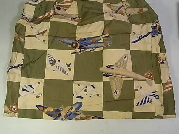 Detail of a child's chan-chan-ko showing Japanese and German aircraft.  This textile would relate to the Anti-Comintern Pact of October 23, 1936. Fascist Italy would join The Tripartite Pact in 1940.