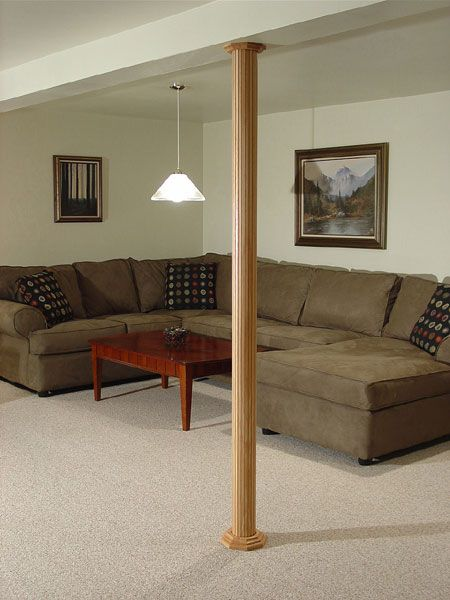 POLE-WRAP beautifully accents your basement poles!  Not only easy to install, but you can paint it.  www.polewrap.com Available at Home Depot.