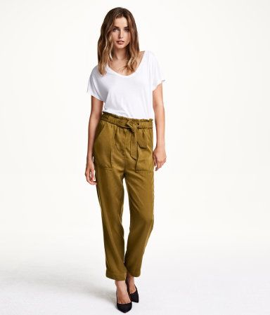 Joggers in woven fabric with a slight sheen, with an elasticated drawstring waist, patch pockets at the front and sewn-in turn-ups at the hems.
