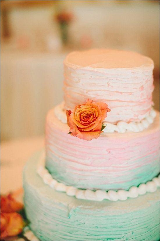 This is a beautiful ombre wedding cake that looks very much like a pastel peacock feather.