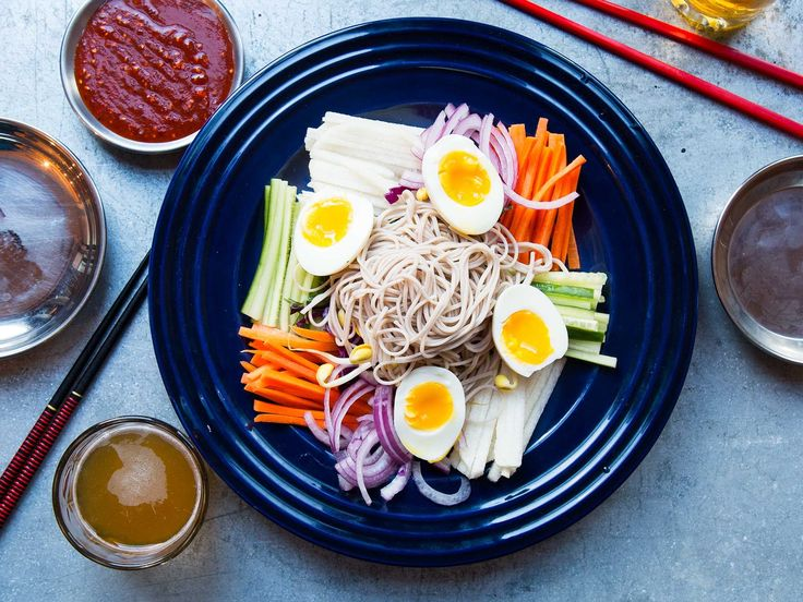 Korean Cold Buckwheat Noodles (Jaengban Guksu) | Don't be fooled by the vegetable-heavy spread; this dish is sure to fill you up. A medley of thinly sliced vegetables is piled up with a mound of cold buckwheat noodles. They're dressed with a slurpable spicy and savory gochujang sauce that makes for a Korean take on a chef's salad.