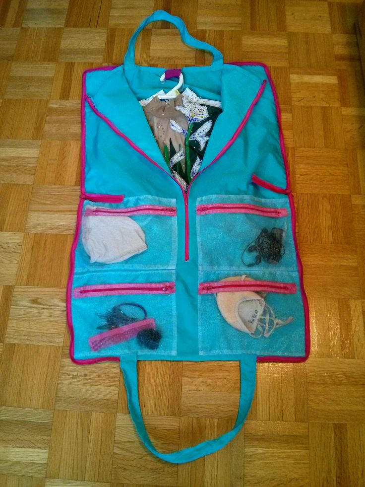 Rhythmic gymnastics leotard and garment bag with a club/personal logo. Made by Nina Leotards