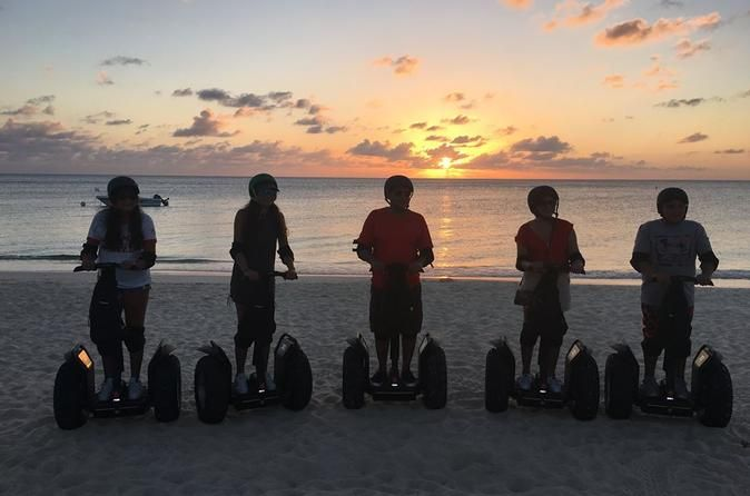 Cayman Islands Seven Mile Beach Sunset Segway Tour Enjoy a 1.5-hour adventure riding a Segway PT along the Seven Mile Beach area, which is located approximately 7 minutes from downtown George Town, Grand Cayman. One of the stops will be Camana Bay where you will experience a 360 degree panoramic views off the island. Next, you will visit Royal Palms for a cool drink. Then you will be thrilled by an unforgettable experience as you ride the Segway PT along the beautiful and famo...