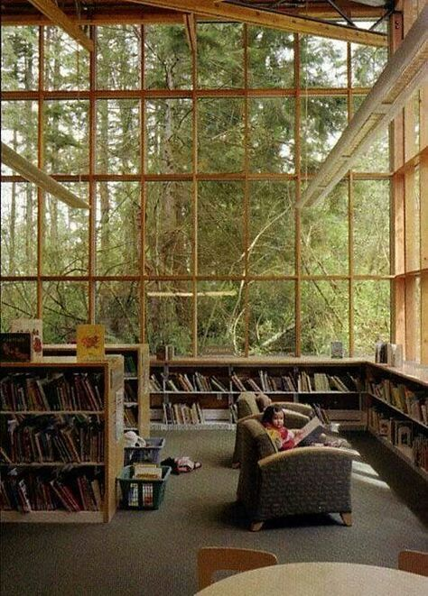 This is stunning. A dream destination, a small cove of heaven surrounded by books and nature. This is pretty cool, but I probably wouldn't get much reading done because my eyes would keep wandering back to the windows.