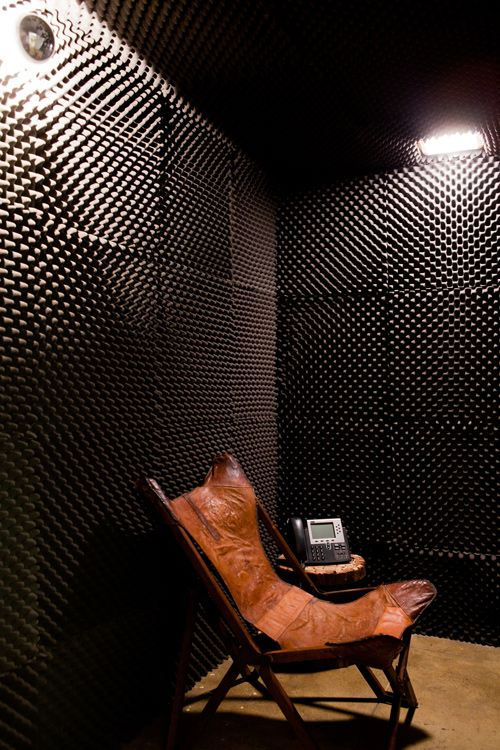 When we were building this room, we joked with the carpenters that this was where we sent people who needed to calm down and that we needed the walls padded so they wouldn't hurt themselves. Really we just wanted a quiet room where people could make calls. The walls are covered in egg-crate packing foam.