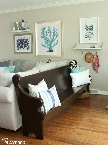 Don't have a mudroom? Create your own with art, shelves, and some hooks!