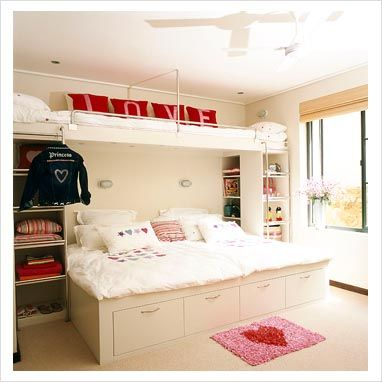 Cabin bed with built-in shelving/storage wither side in this kid's bedroom.