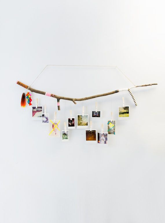 These hand crafted tree branch photo hangers add an alluring modern woodland touch to any home or space. Each one-of-a-kind branch combines the beauty