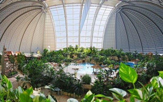 Gigantic airship hangar transformed into a tropical island resort complete with the world's largest indoor pool and water park