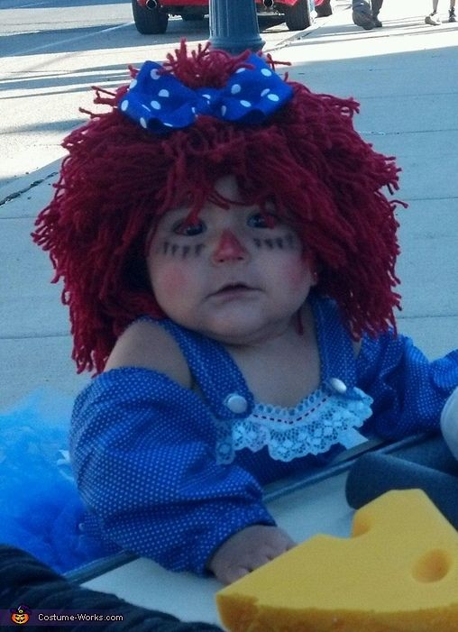 Adorable homemade Raggedy Ann costume! To make the hair, I crocheted a beanie and tied strings all around it. I made a no sew tutu skirts its attached diaper cover underneath, a corset-like top with sleeves, and red and white striped tights which I colored in with a red permanent marker