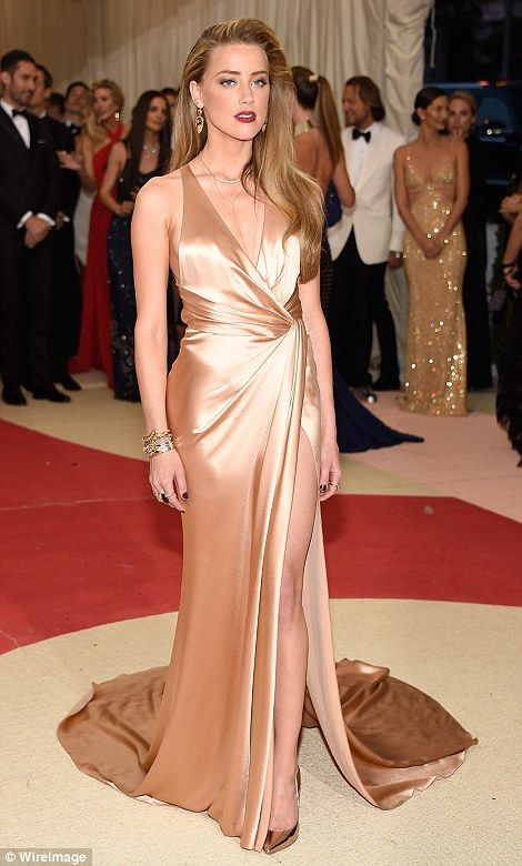 Golden goddess: Amber Heard left husband Johnny Depp at home as she made a glamorous appearance in gold satin