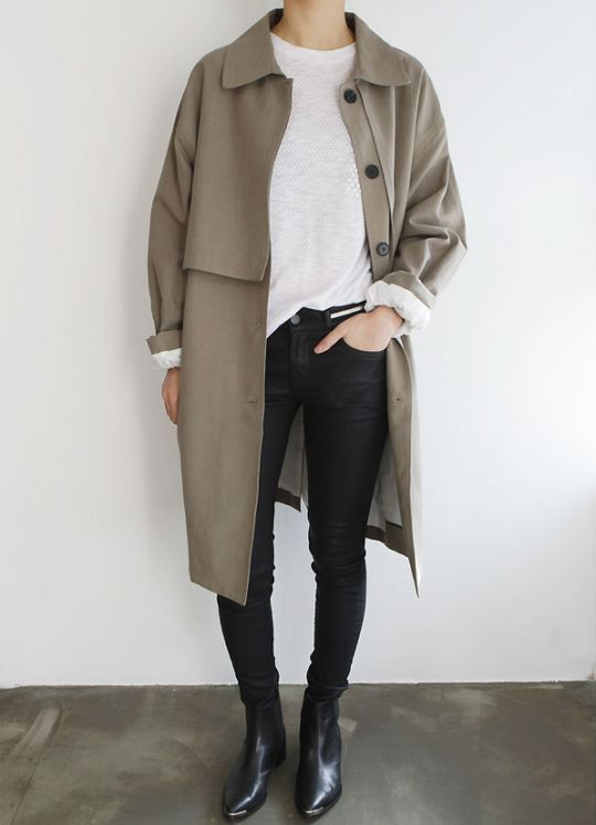 Combine jeans and fancy boots. Finish with a long jacket for the perfect casual work outfit.