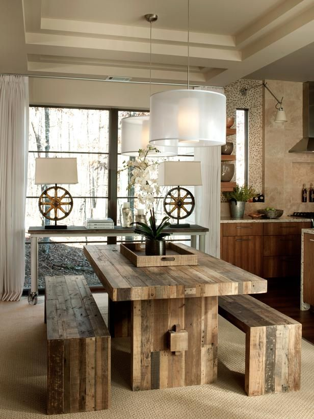 HGTV's Green home 2012.  Dining table made from FSC pine reclaimed from shipping pallets. The console, topped with reclaimed wood is on casters to allow for mobility. The lamps on the console are made from vintage foundry gears.