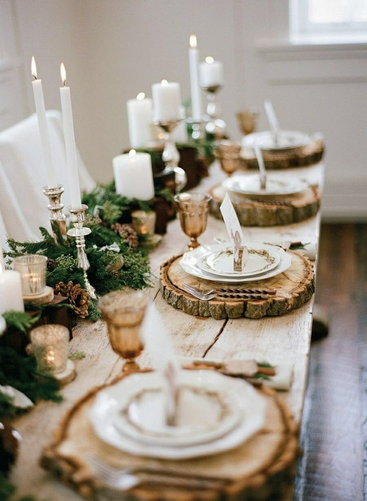 the holiday table, silver candlesticks, wood chargers, greenery