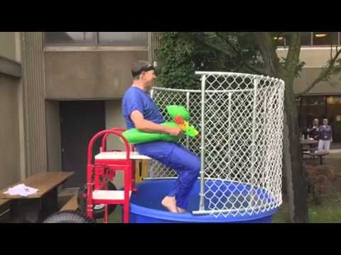 Dave Williams, President and CEO of Southlake Regional Health Centre falls into to the dunk tank (in slow motion) during the annual Recognition BBQ at Southlake.