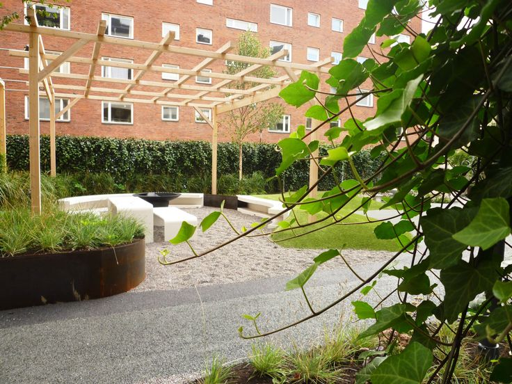 Courtyard in Stockholm, ivy, pergola, concrete, cortén, grill place. Design and planting by Garden by anna.