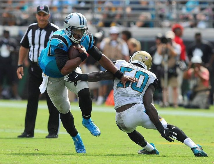 Carolina Panthers quarterback Cam Newton breaks inside of Jacksonville Jaguars linebacker Telvin Smith's left arm to pick up yardage during fourth quarter action at EverBank Field in Jacksonville, FL on Sunday, September 13, 2015. The Panthers defeated the Jaguars 20-9.