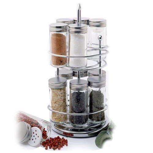 Norpro Spice Rack with Rotating Stand by Norpro. $41.74. Measures 11 inches/28cm and has two levels. Includes 12 glass jars with steel lids and snap-on shaker caps; each jar holds 3 ounces. The spice rack rotates so you will always find the spices you need. Hand washing recommended. The spice rack is attractive and takes up little countertop space. This quality rotating spice rack looks attractive on any countertop and takes up little space.  Comes with 12 glass j...