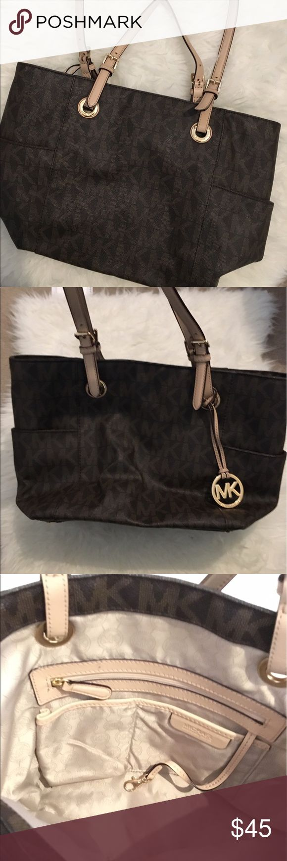 Michael Kors Monogram Tote Bag The straps are a little dirty / purse on the inside and outside is in good condition / no trades sorry / make an offer that is reasonable 💕 Michael Kors Bags Totes