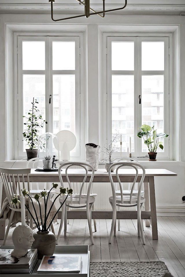 A soothing Swedish space. light and airy diningroom, thonet chairs