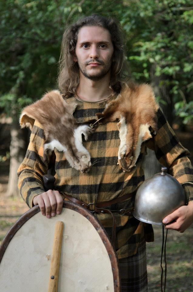 a person representing a Celtic warrior of Senones tribe. The iron helmet, sword and scabbard indicate his prosperity and probably his noble lineage. By Riproduzioni Storiche (www.riproduzionistoriche.com)