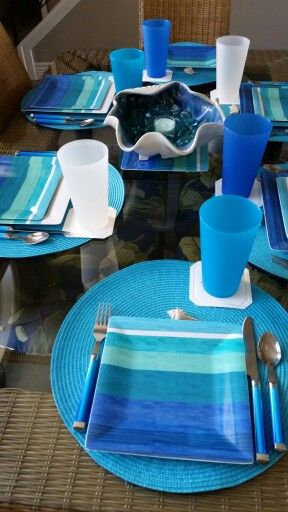 Sea side table theme.  Shell in the center from Pier 1, glasses from BBB, plates Smith's grocery store, silverware from Herberger's.