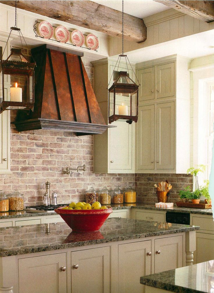 @Linda Patton The exposed brick in this kitchen with the copper and textured countertops, wood beams, and pops of cream help to make this kitchen country style without frills and chickens!