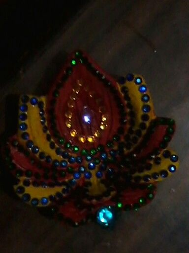 I made this diya on my diya decoration competition in school and i won 1st prize in it
