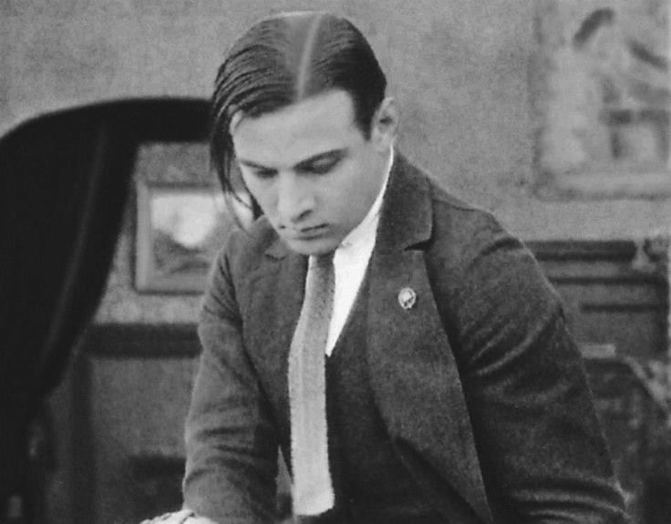 Rudolph Valentino with his hair slightly askew. Unusual for him. Looks like the photographer caught him off guard.