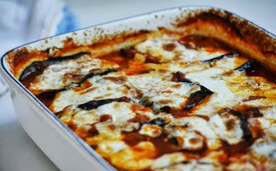 Sheik al Mehshee Recipe-an Arabic Eggplant casserole with broiled (or roasted) sliced eggplant, chopped onions and garlic, ground beef or lamb, pine nuts, tomato sauce and spices. Topped with cheese and baked like lasagna.