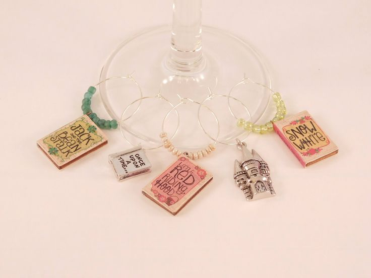 A personal favorite from my Etsy shop https://www.etsy.com/listing/560640782/story-book-wine-charms-wine-charm-set
