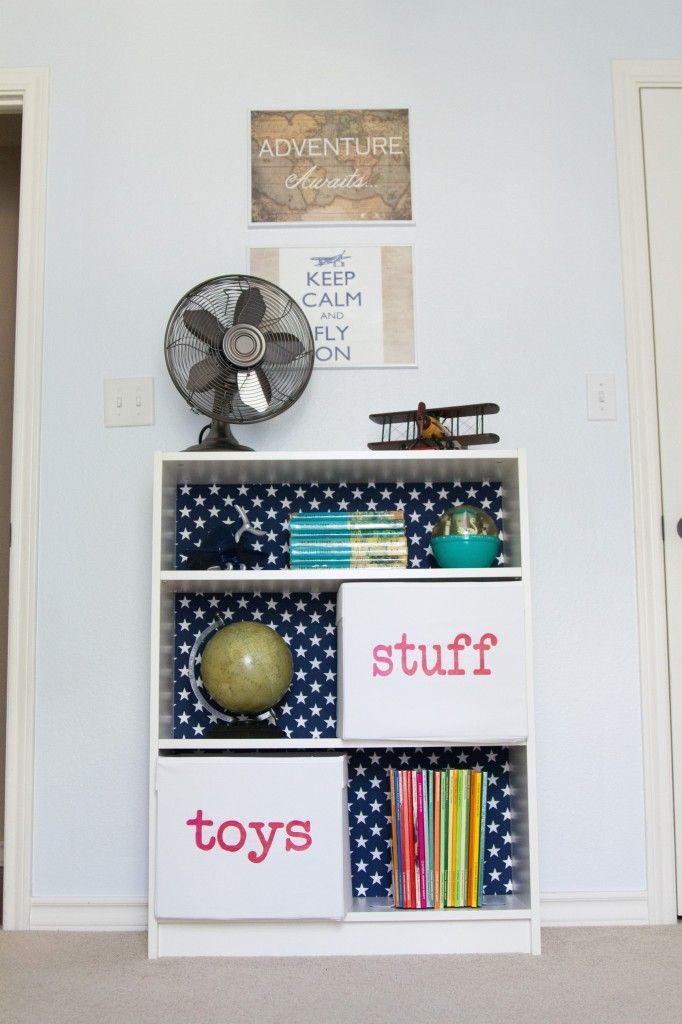 Jazz up an inexpensive bookcase by adding a fun fabric to the back! #nursery #kidsroom #designidea #DIY