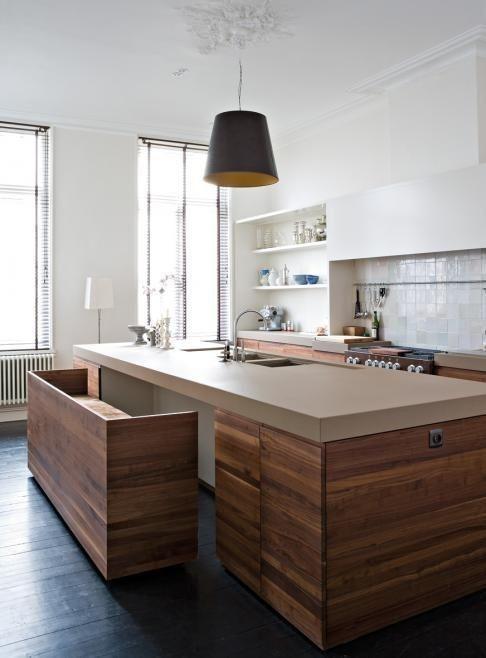 20 Gorgeous Kitchens with Islands Interiorforlife.com Space saver   A bench seat hidden in a kitchen island.