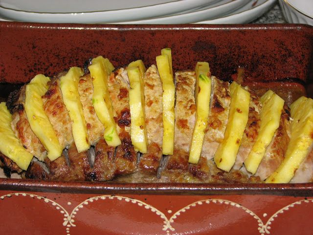 Oven baked ribs with potatoes and pineapple