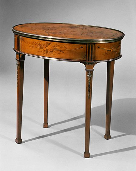 Oval table, ca. 1774–80 David Roentgen (German, 1743–1807) Oak, walnut, pine, cherry, cedar, and maple, veneered with maple, hornbeam, holly (all partially stained), cherry, mahogany, tulipwood, and other woods; gilt bronze, iron, brass, steel; partially tooled and gilded leather - The Metropolitan Museum of Art
