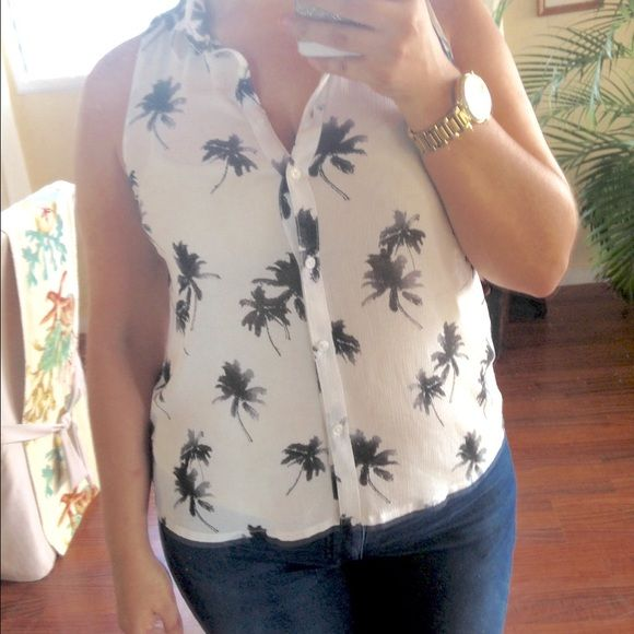 American Eagle Palm Tree Tank Top Perfect for Spring and Summer! This easy breezy top is printed with palm trees to enjoy the warmer weather. Button up detail makes this cute top fun for the office with a cardigan or without when you're out and about during the day. I wore this top over a neutral Cami to offset sheerness. Top has been worn twice - Great condition! American Eagle Outfitters Tops Tank Tops