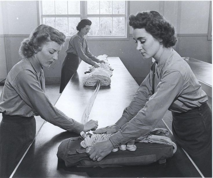 Women Marines learning how to rig parachutes at the training school at Camp Lejeune, North