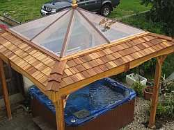 Large clear roof on cedar hot tub gazebo