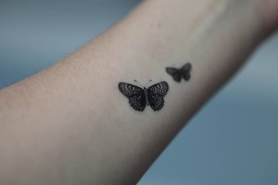 Crescent Butterflies!  Tiny intricate tattoo work with these two on wrist. lovely.