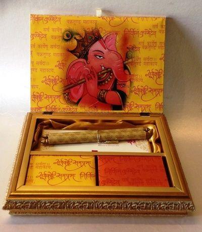yellow and red invitation box, ganesh inspired card, scroll wedding card