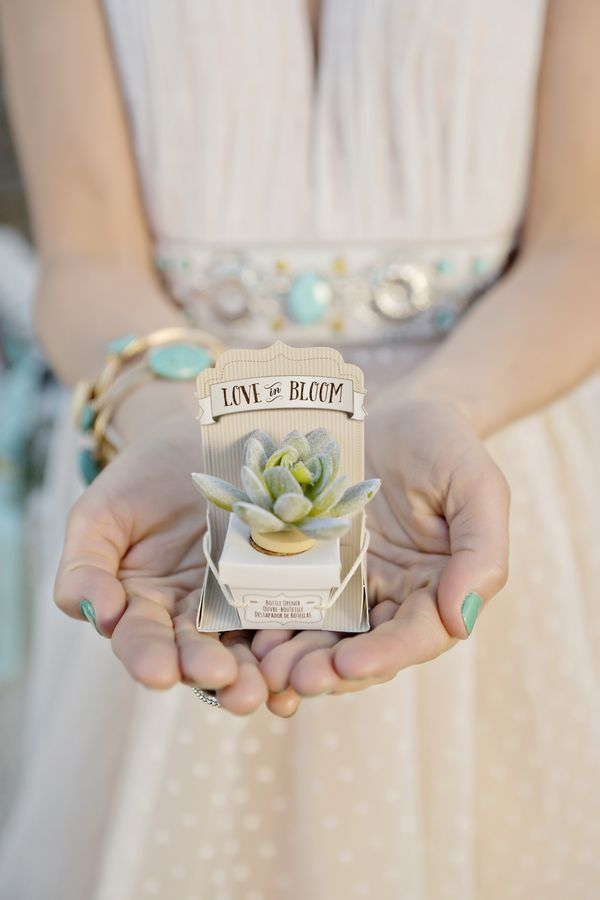 """Faux succulent bottle stoppers are a fitting choice for a boho wedding theme. Send each guest home with a little """"thank you"""" for helping you celebrate your big day!   Andie Freeman Photography"""
