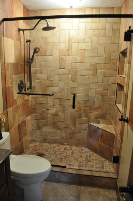 Small Master Bath Remodel, Master bath with complete tile shower, herringbone pattern on back shower wall. Glass shower doors. Tile floor. 6 different types/colors of tile. Boulder vessel sink with marble vanity top. All work was done by me (a DIYer) with exception of the shower door., Shower with frameless glass shower door, Bathrooms Design