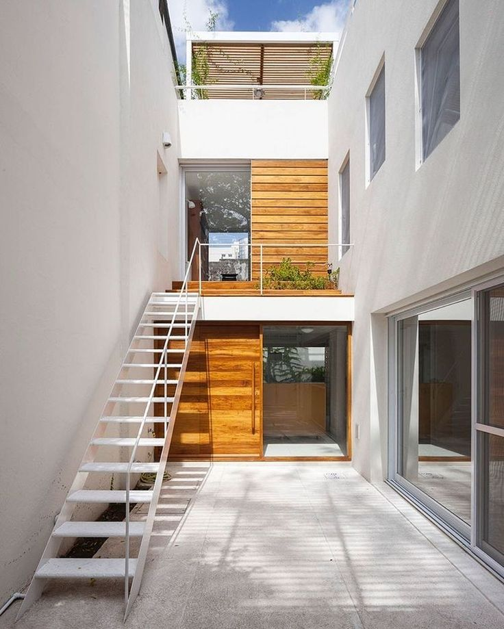 This Buenos Aires house by Ana Rascovsky Arqs was renovated to serve as both a home and workplace for a young couple. An entrance courtyard provides both access to the residential area and the separate studio one level above. : Javier Agustin Rojas. #architecture #interior #design #interiordesign #courtyard #house #buenosaires... - Interior Design Ideas, Interior Decor and Designs, Home Design Inspiration, Room Design Ideas, Interior Decorating, Furniture And Accessories